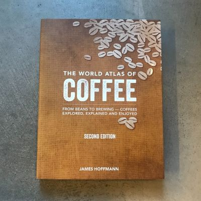 """Front cover of The World Atlas of Coffee by James Hoffman. """"From Beans to Brewing - Coffees Explored, Explained and Enjoyed"""""""