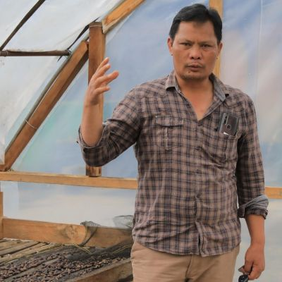 Asman Arianto, who heads the Ribang Gayo coffee cooperative, showing us inside some of the newer domed coffee drying rooms in Pantan Musara, Sumatra.